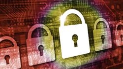 Das Themenbild Cybersicherheit zeigt ein Schloß auf einer Leiterplatte.