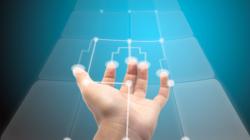 Das Themenbild Usability zeigt eine durchsichtige Touchfläche und eine Hand, die diverse Punkte auf dieser aktiviert.